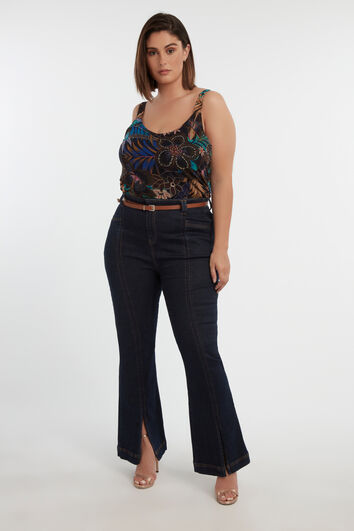 High waist jeans met splits