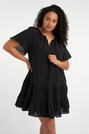 Korte uitlopende jurk